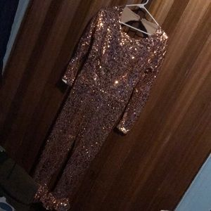 A pink glittery jumpsuit
